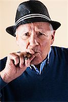 Portrait of Senior Man Smoking Cigar Stock Photo - Premium Royalty-Freenull, Code: 600-06382928