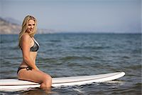 Surfer Sitting on Surfboard Stock Photo - Premium Rights-Managednull, Code: 700-06383763