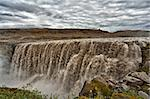 Dettifoss is the most powerful waterfall on Iceland and in the whole Europe. It is located in Jokulsargljufur National Park the northeasten Iceland on the river Jokulsa a Fjollum. Stock Photo - Royalty-Free, Artist: Fyletto                       , Code: 400-06384103