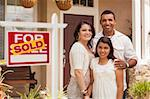 Hispanic Mother, Father and Daughter in Front of Their New Home with Sold Home For Sale Real Estate Sign. Stock Photo - Royalty-Free, Artist: Feverpitched                  , Code: 400-06384253