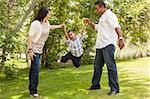 Happy Hispanic Mother and Father Swinging Son in the Park. Stock Photo - Royalty-Free, Artist: Feverpitched                  , Code: 400-06384257
