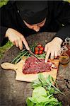 Cooking ingredients: marinated meat,oil,vinegar, herbs and vegetables. Chef is carving and marinating meat. Stock Photo - Royalty-Free, Artist: mythja                        , Code: 400-06388111