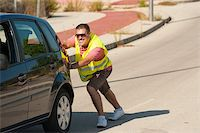 stalled car - Breakdown and nobody  around, time for some pushing Stock Photo - Royalty-Freenull, Code: 400-06388723