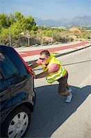 stalled car - A breakdown and the following unpleasant job Stock Photo - Royalty-Freenull, Code: 400-06388725
