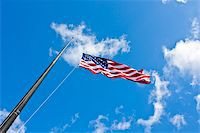 flag at half mast - American flag on a blue sky during a windy day Stock Photo - Royalty-Freenull, Code: 400-06389956