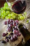 Wine concept. Food and drink background with red wine, fresh grapes and wine bottle Stock Photo - Royalty-Free, Artist: mythja                        , Code: 400-06391104