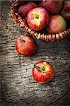 Fresh harvest of apples. Nature theme with red grapes and basket on wooden background. Nature fruit concept. Stock Photo - Royalty-Free, Artist: mythja                        , Code: 400-06391108