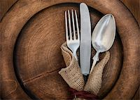 fork - Vintage silverware on rustick wooden plate Stock Photo - Royalty-Freenull, Code: 400-06392102