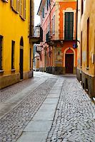 Narrow Alley with Old Buildings in the Italian City of Cuneo Stock Photo - Royalty-Free, Artist: gkuna, Code: 400-06392641