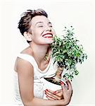 laughing girl with a plant in hand Stock Photo - Royalty-Free, Artist: vicnt                         , Code: 400-06393355