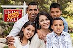 Happy Hispanic Family in Front of Sold Home for Sale Real Estate Sign. Stock Photo - Royalty-Free, Artist: Feverpitched                  , Code: 400-06394075
