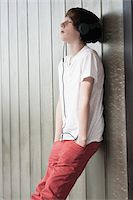 Boy Leaning against Wall and Listening to Music, Mannheim, Baden-Wurttemberg, Germany Stock Photo - Premium Royalty-Freenull, Code: 600-06397450