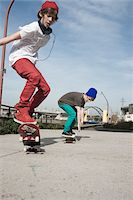 Boys Skateboarding Outdoors, Mannheim, Baden-Wurttemberg, Germany Stock Photo - Premium Royalty-Freenull, Code: 600-06397458