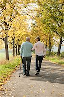 Mature Woman Walking with Senior Father in Autumn, Lampertheim, Hesse, Germany Stock Photo - Premium Royalty-Freenull, Code: 600-06397468
