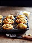 Garlic Dinner Rolls in Muffin Tin with Butter Stock Photo - Premium Royalty-Free, Artist: Jodi Pudge, Code: 600-06397657