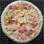 Overhead View of Frozen Hawaiian Pizza Stock Photo - Premium Royalty-Free, Artist: Andrew Kolb, Code: 600-06397693