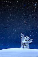 Angel statue and stars Stock Photo - Premium Royalty-Freenull, Code: 622-06398376