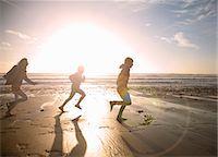 pre-teen beach - Family running together on beach Stock Photo - Premium Royalty-Freenull, Code: 649-06400399