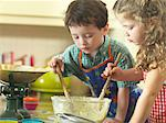 Children baking together in kitchen Stock Photo - Premium Royalty-Free, Artist: Glowimages, Code: 649-06400420