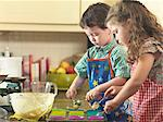 Children baking together in kitchen Stock Photo - Premium Royalty-Free, Artist: Photocuisine, Code: 649-06400421