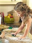 Girl cutting out cookies in kitchen Stock Photo - Premium Royalty-Free, Artist: Photocuisine, Code: 649-06400426