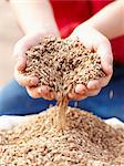 Farmer pouring handful of barley seeds Stock Photo - Premium Royalty-Freenull, Code: 649-06400465