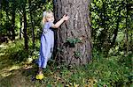 Girl hugging tree in forest Stock Photo - Premium Royalty-Free, Artist: Dana Hursey, Code: 649-06400727