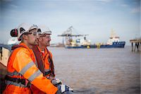 ships at sea - Workers on tug boat overlooking ocean Stock Photo - Premium Royalty-Freenull, Code: 649-06400905