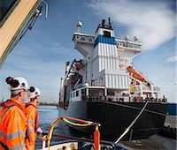 ships at sea - Workers on tug boat overlooking ship Stock Photo - Premium Royalty-Freenull, Code: 649-06400931