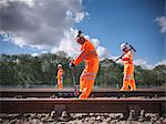 Railway workers adjusting train tracks Stock Photo - Premium Royalty-Free, Artist: Robert Harding Images, Code: 649-06400949