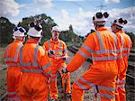 Railway workers talking on train tracks Stock Photo - Premium Royalty-Free, Artist: Blend Images, Code: 649-06400957