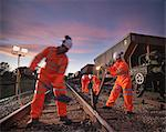 Railway worker adjusting train tracks Stock Photo - Premium Royalty-Free, Artist: Westend61, Code: 649-06400973