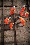 Railway workers examining train tracks Stock Photo - Premium Royalty-Free, Artist: Robert Harding Images, Code: 649-06400987