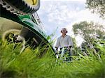 Low angle view of man mowing lawn Stock Photo - Premium Royalty-Free, Artist: Cultura RM, Code: 649-06400999