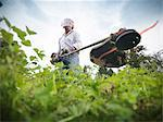 Man trimming weeds in garden Stock Photo - Premium Royalty-Free, Artist: Shannon Ross, Code: 649-06401009