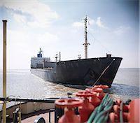 ships at sea - Tugboat pulling ship in ocean Stock Photo - Premium Royalty-Freenull, Code: 649-06401031