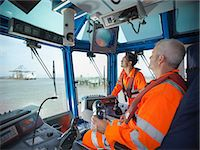 ships at sea - Tugboat workers in wheelhouse Stock Photo - Premium Royalty-Freenull, Code: 649-06401070