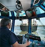 Captain steering tugboat in wheelhouse Stock Photo - Premium Royalty-Free, Artist: Jose Luis Stephens, Code: 649-06401075
