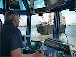 Captain steering tugboat in wheelhouse Stock Photo - Premium Royalty-Free, Artist: IIC, Code: 649-06401077