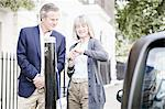 Couple charging electric car on street Stock Photo - Premium Royalty-Freenull, Code: 649-06401080