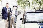 Couple charging electric car on street Stock Photo - Premium Royalty-Freenull, Code: 649-06401081
