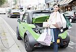 Woman loading shopping bags in car Stock Photo - Premium Royalty-Freenull, Code: 649-06401114
