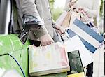 Couple loading shopping bags in car Stock Photo - Premium Royalty-Freenull, Code: 649-06401119