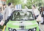 Couple loading shopping bags in car Stock Photo - Premium Royalty-Freenull, Code: 649-06401120