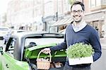 Man loading produce into car Stock Photo - Premium Royalty-Free, Artist: Aflo Relax, Code: 649-06401131