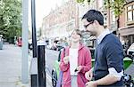 Couple charging electric car on street Stock Photo - Premium Royalty-Freenull, Code: 649-06401143