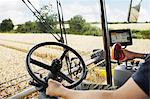 Farmer driving harvester in crop field Stock Photo - Premium Royalty-Free, Artist: Michael Mahovlich, Code: 649-06401242