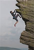 Rock climber scaling rock formation Stock Photo - Premium Royalty-Freenull, Code: 649-06401315