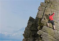 Rock climber scaling rock formation Stock Photo - Premium Royalty-Freenull, Code: 649-06401317