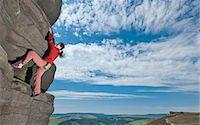 rock climber - Rock climber scaling rock formation Stock Photo - Premium Royalty-Freenull, Code: 649-06401321